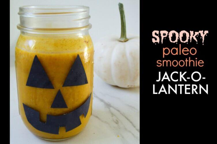 Spooky Paleo Smoothie Pumpkin Jack-O-Lantern - You & your kids will LOVE our spooky paleo smoothie & drink recipes, made completely in decorated mason jars! Keep halloween healthy and dairy-free, while being festive, & fun. Craft a diy mason jar ghost, monster, pumpkin jack-o-lantern, or mummy using just a permanent marker, glue stick, and paper!