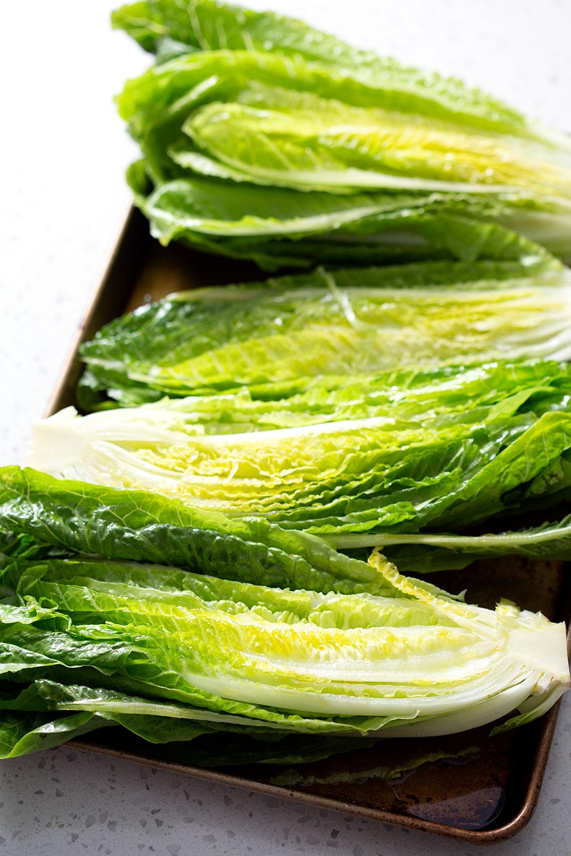raw romaine lettuce on baking sheet