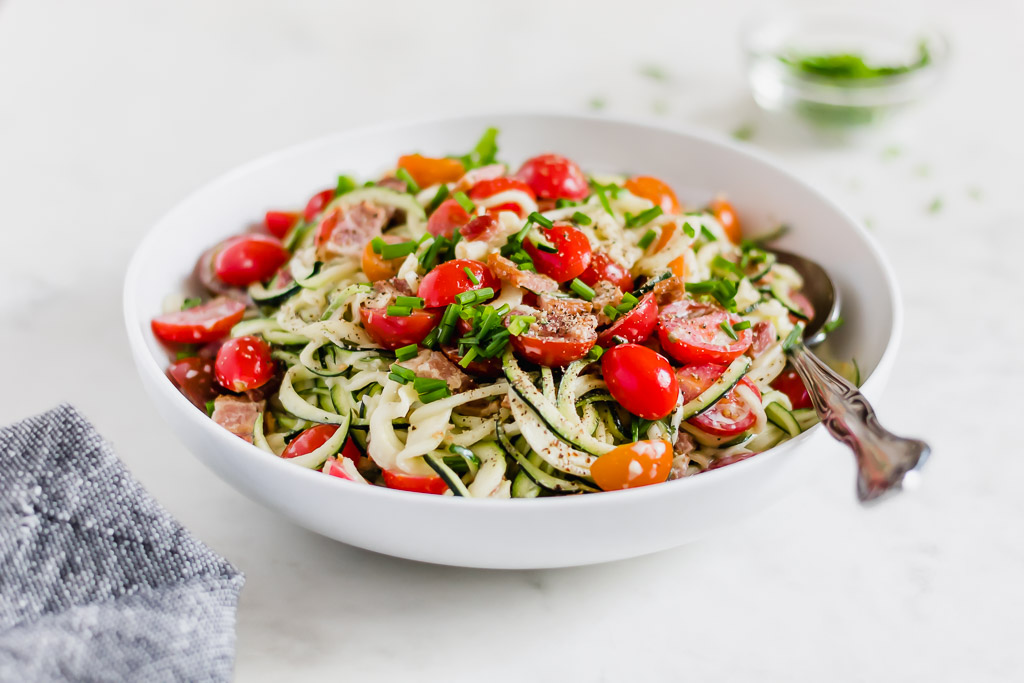 Zucchini noodle, bacon and tomato salad