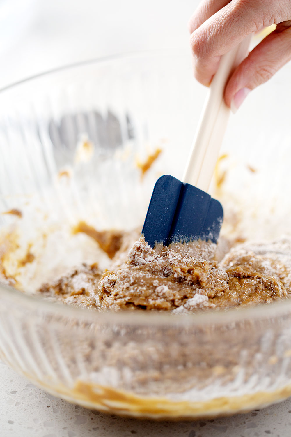 mixing batter with spatula