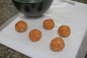 Carrot cake energy balls in process image